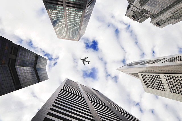 Airplane Over Skyscrapers image